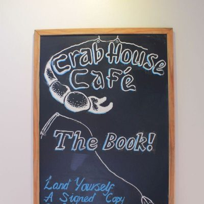 Crab House Cafe - Book promotion board